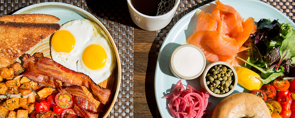 The Sebastian Vail breakfast is ready with a hot cup of coffee.