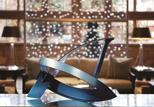A modern centerpiece sits on a designer table.