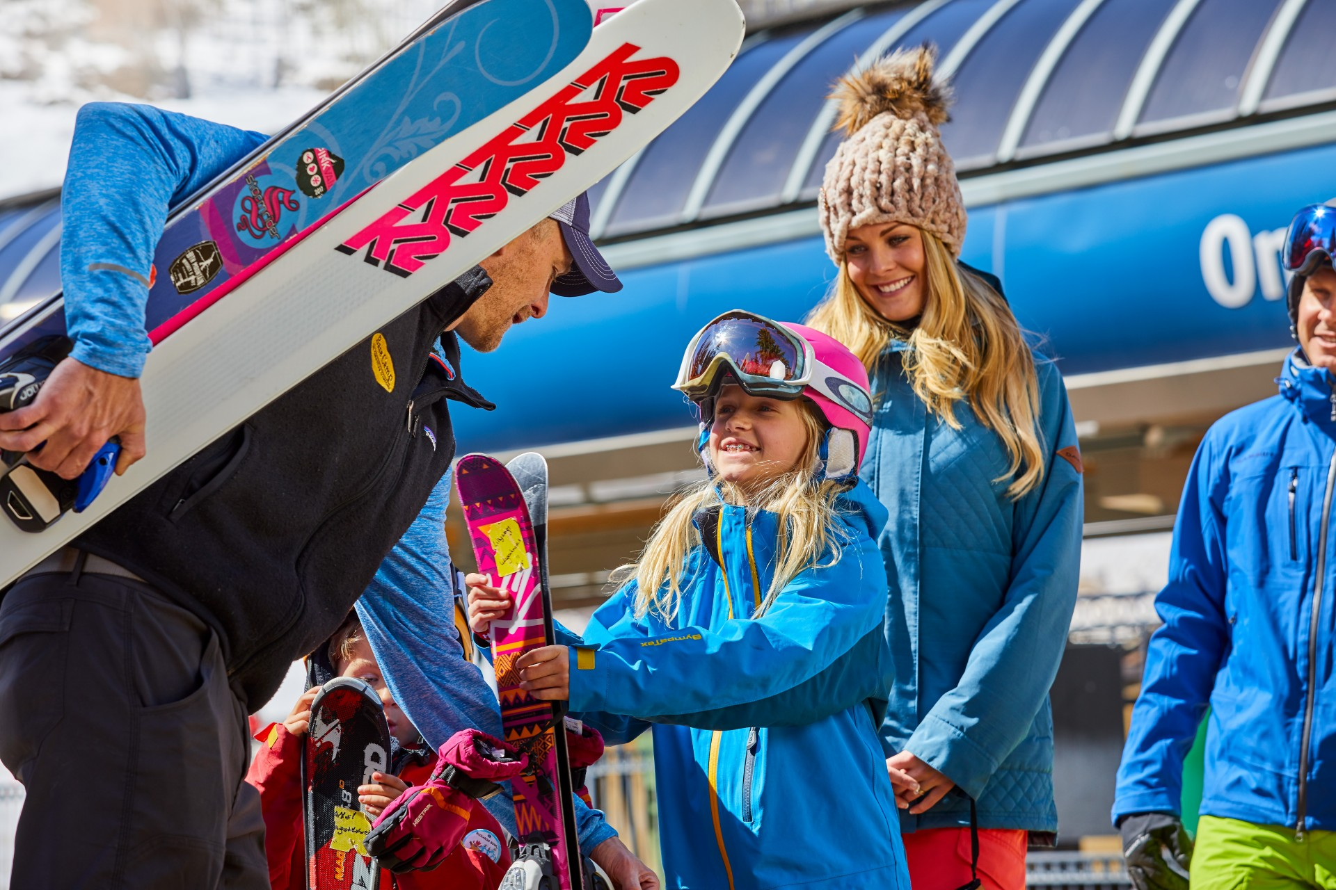A happy family gets ready to ski Vail Mountain with the help of Base Camp ski valet.