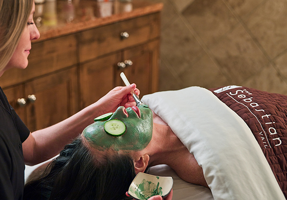 A bottle of massage oil sits on a table in the Sebastian - Vail's spa.