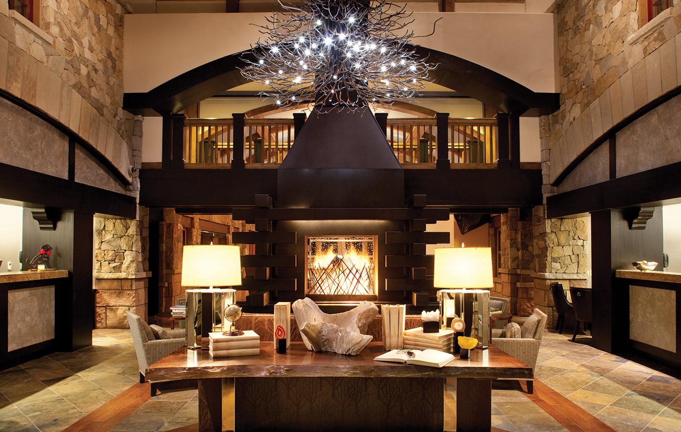 The warm interior of the Sebastian-Vail hotel lobby welcomes guests.