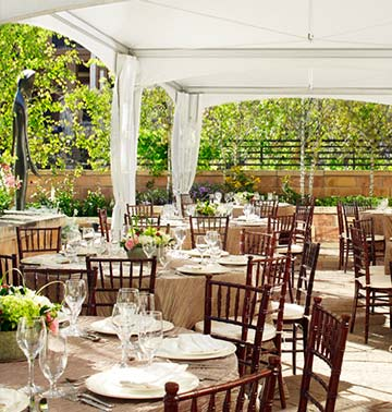 Flowers and tables sit under a beautiful wedding veranda at a Vail venue.