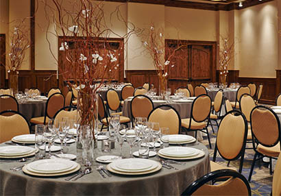 A banquet hall at The Sebastian includes gorgeous table centerpieces for a Colorado event.