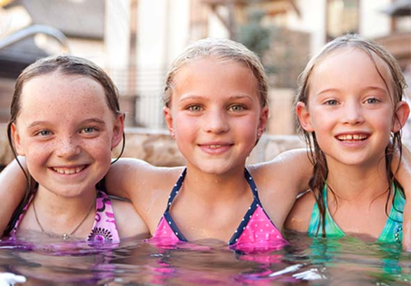 Happy children enjoy the pool at the best hotel in Vail.
