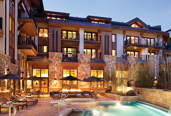 The pool of The Sebastian - Vail's boutique hotel sits heated at night.