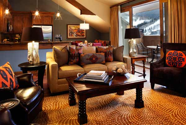 A living room of a Residence at The Sebastian - Vail appears cozy and inviting.