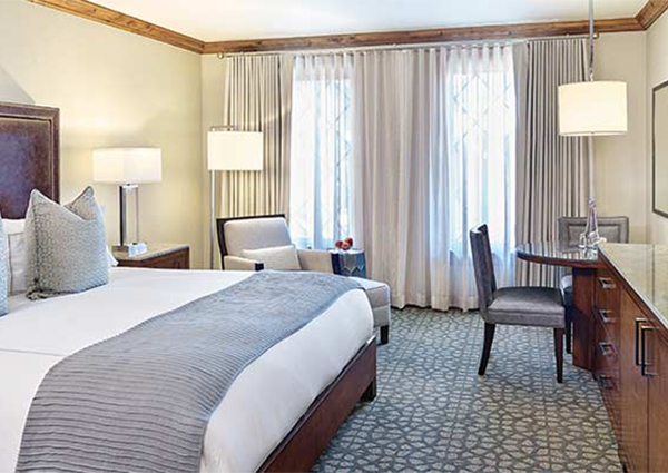 A clean, comfortable hotel room in Vail is ready for guests.