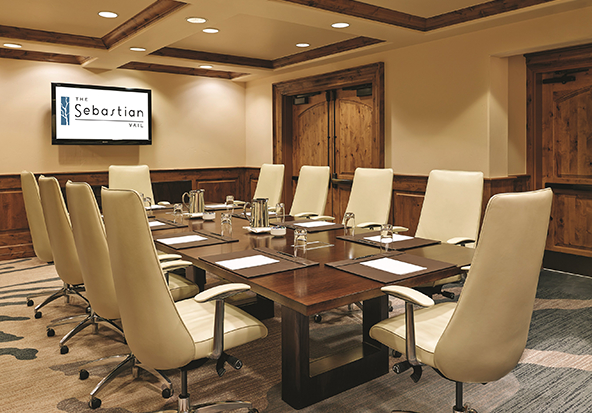 A meetings space at The Sebastian - Vail features a beautiful conference table.
