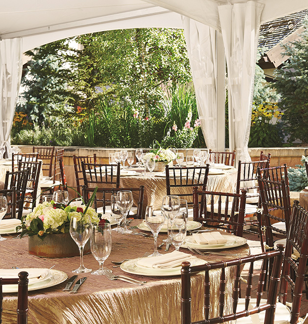 The mountain view wedding venue holds tables and chairs.