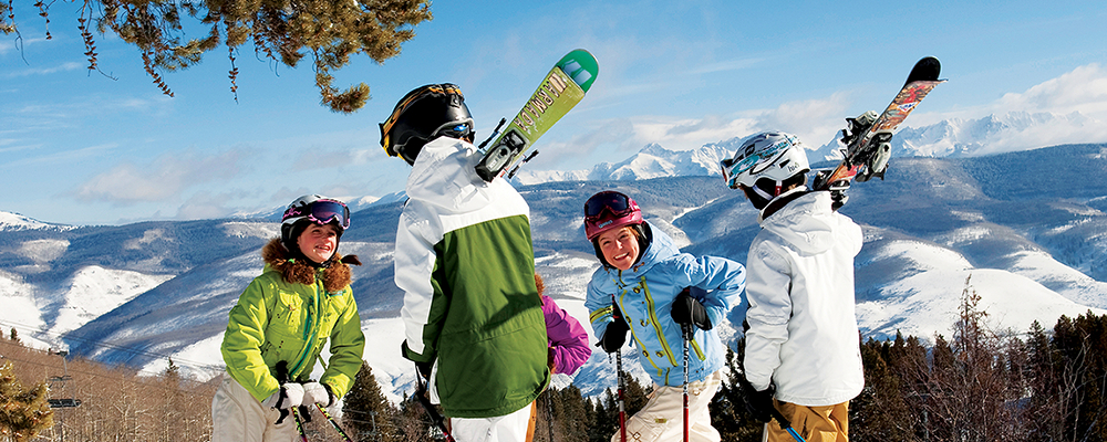 A happy family skis and enjoys their fun Vail vacation.