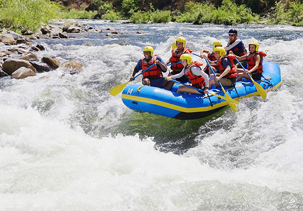 A group of coworkers go white water rafting in Vail after a meeting.