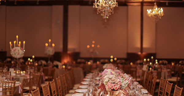 A beautiful Vail wedding reception venue sits dimly lit for dinner.