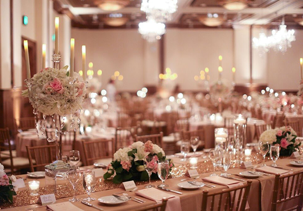 A stunning Vail wedding reception venue features flowers and candles.