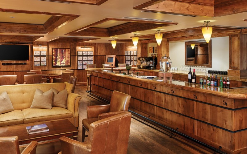 The Sebastian Vail's real estate owners lounge features a bar and sitting area.