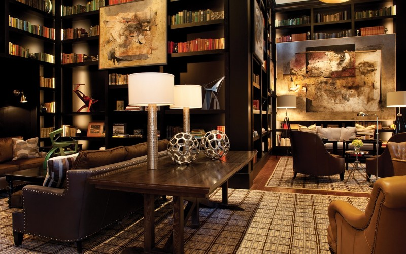 The Library at The Sebastian Vail luxury hotel features art work, books and seating where guests can relax.