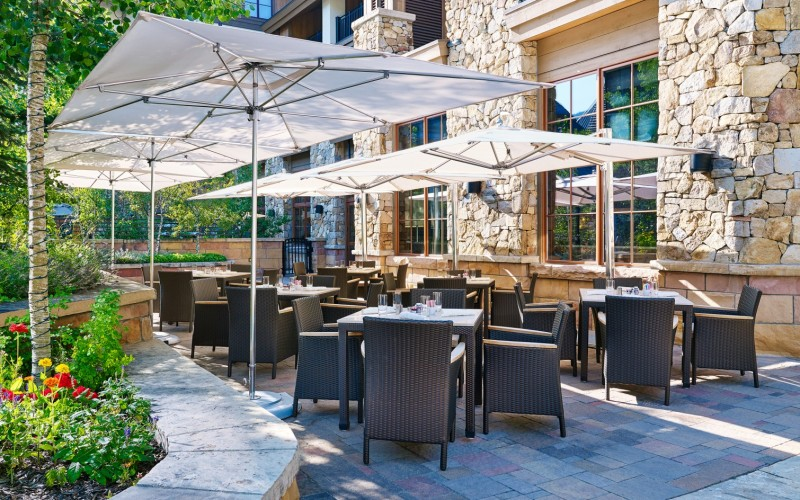 The Grand Terrace features outdoor tables and umbrellas for a Vail event.