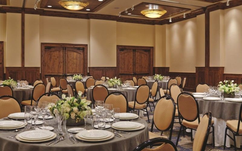 The Ariel Ballroom is set up with banquet tables for a Colorado wedding at The Sebastian.