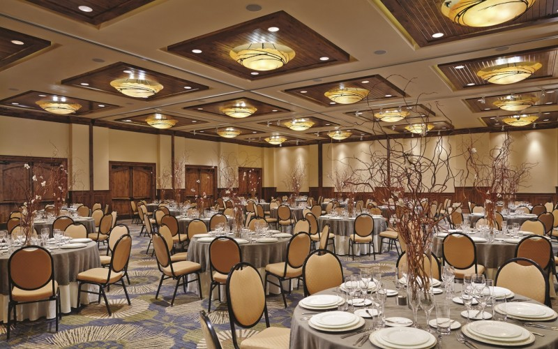 The Ariel Ballroom in Vail, Colorado is set up with dining tables for a banquet event.