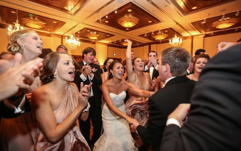 A wedding group celebrates on the dance floor at The Sebastian Vail hotel