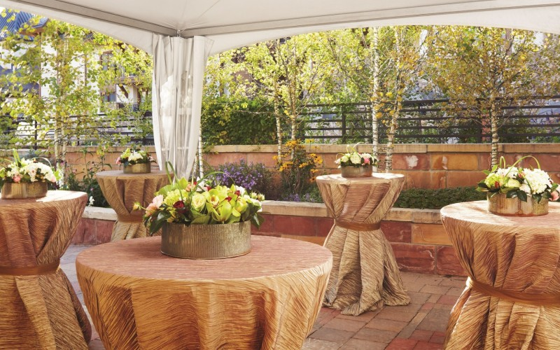 The Mountain View Terrace is set up with cocktail tables for a Vail wedding.